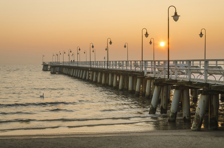 pier in Gdynia Orlowo in poland after sunrise in wintertime, europe Stock Photo