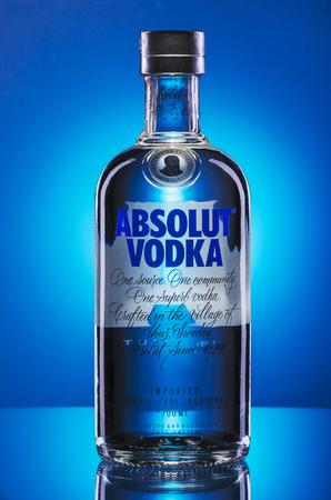 Absolut vodka on blue background.