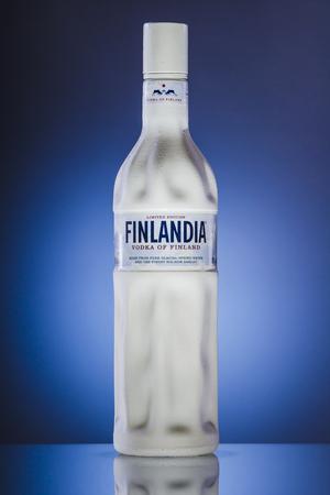 dewed: Finland vodka on blue background