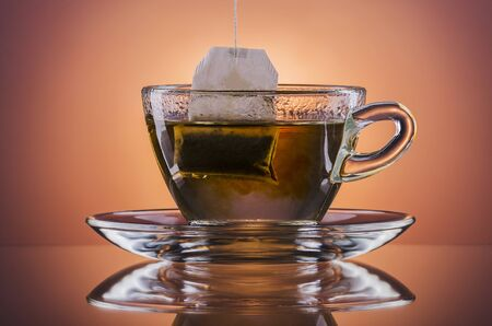 A cup of hot tea on a gradient background