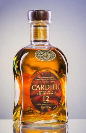Cardhu whiskey on gradient background. Editorial