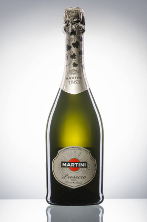 Bottle of sparkling wine isolated on gradient background.