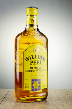 William Peel whiskey on gradient background.
