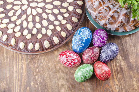 colorful handmade easter eggs on wooden table