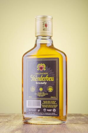 Bottle of original albanian brandy Skenderbeu on gradient background
