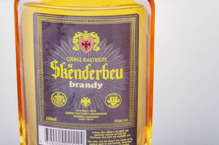 Bottle of original albanian brandy Skenderbeu on gradient background.