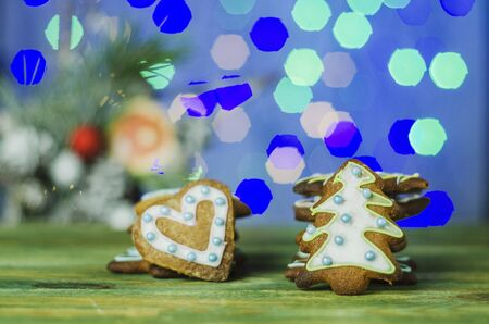 Delicious decorated Christmas cookies on bokeh background