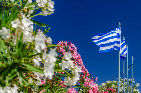 National flag of Greece waving against blue sky