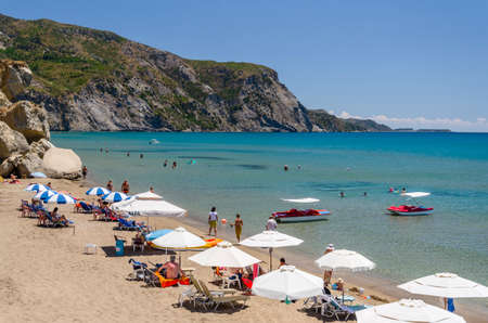 Picturesque sandy beach in Kalamaki situated on Laganas bay of Zakynthos island on Ionian Sea, Greece.