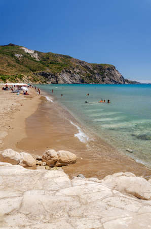 Picturesque golden sandy beach in Kalamaki situated on Laganas bay of Zakynthos island on Ionian Sea, Greece.