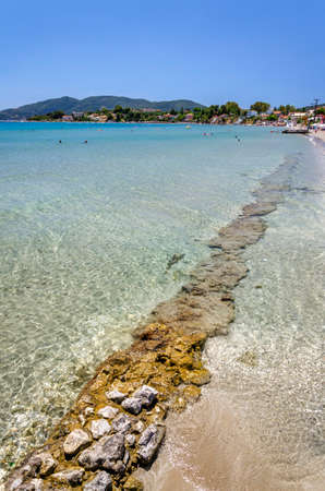 Picturesque golden sandy beach in Laganas situated on Laganas bay of Zakynthos island on Ionian Sea, Greece.
