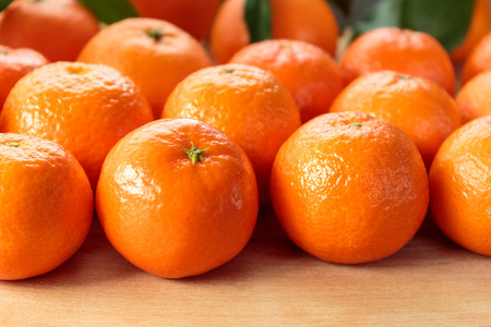 clementines: Clementines on rustic wooden table Stock Photo