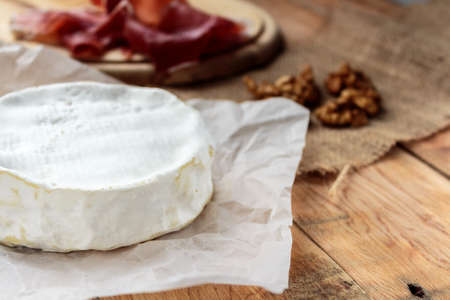 camembert: Camembert on old rustic wooden table Stock Photo