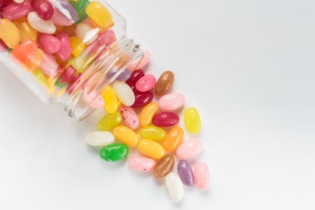 jellybean: Jelly beans in glass jar on white background Stock Photo