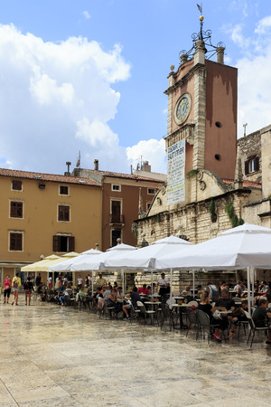guard house: ZADAR, CROATIA - AUGUST 17, 2015: Street view of Guard house in Zadar, Croatia with clock tower dating back to 16th century on Peoples Square.