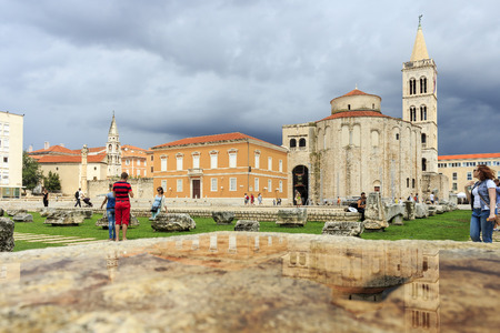 ZADAR, CROATIA - AUGUST 17, 2015: Church of St. Donat and forum in Zadar, Croatia. The Church was built in the 9th century and it's example of Byzantine architecture in Dalmatia.