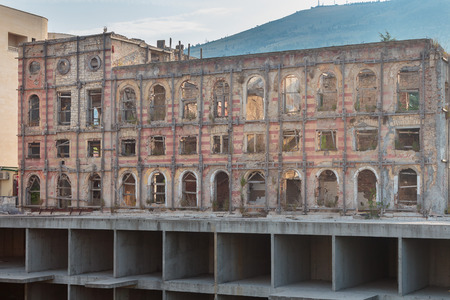 neretva: MOSTAR, BOSNIA AND HERZEGOVINA - AUGUST 15, 2015: Hotel Neretva destroyed during the war in Bosnia and Herzegovina Editorial