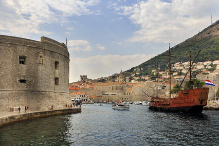 television show: DUBROVNIK, CROATIA - AUGUST 13, 2015: HBO television show Game of Thrones tourist sailing ship entering a harbour of the old town of Dubrovnik, Croatia.