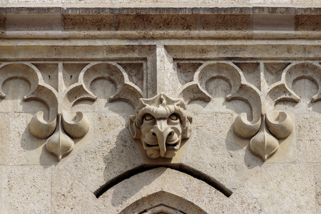 heads old building facade: Stone gargoyle head on church