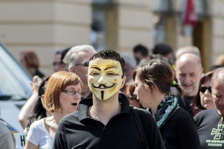 occupy movement: ZAGREB, CROATIA - APRIL 25, 2015: Man wearing Anonymous mask during a protest against rising interest on loans in Swiss francs in Croatia, Zagreb