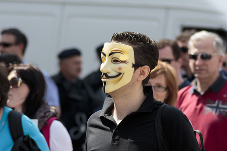 occupy wall street: ZAGREB, CROATIA - APRIL 25, 2015: Man wearing Anonymous mask during a protest against rising interest on loans in Swiss francs in Croatia, Zagreb