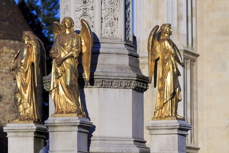 angels fountain: ZAGREB, CROATIA - AUGUST 28, 2014: Golden Angels sculpture, fountain in front of cathedral in Zagreb, Croatia