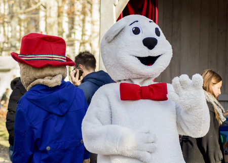 ZAGREB, CROATIA - DECEMBER 13, 2014: Advent in Zagreb, Croatia. Man in bear costume entertaining visitors of Advent in Zagreb