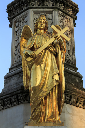 angels fountain: Gold Angel holding a cross sculpture, fountain in front of cathedral in Zagreb, Croatia