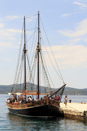 ZADAR, CROATIA - JULY 15, 2014: Wooden tourist ship anchored in the harbor waiting for tourists to come aboard