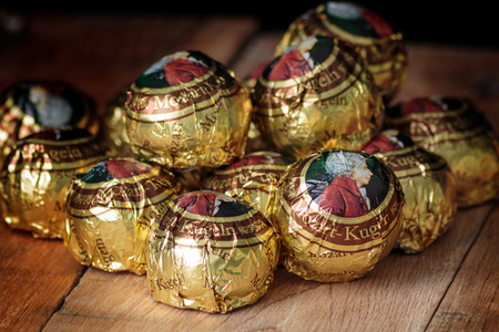 wolfgang: ZAGREB, CROATIA - OCTOBER 16, 2016: The Mozartkugeln, is a small, round sugar confection made of pistachio marzipan, and nougat, covered with dark chocolate. It was originally known as Mozart-Bonbon