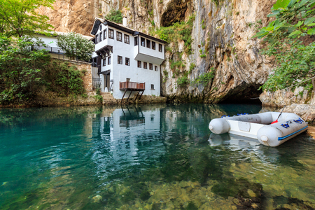Tekija (Tekke) Blagaj Dervish house, important monument of the early Ottoman period in Bosnia and Herzegovina and boat in Buna river spring Editorial
