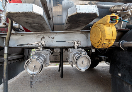 Valves on trailer tank used to dispense liquids like milk and all the way to dangerous goods Stock fotó