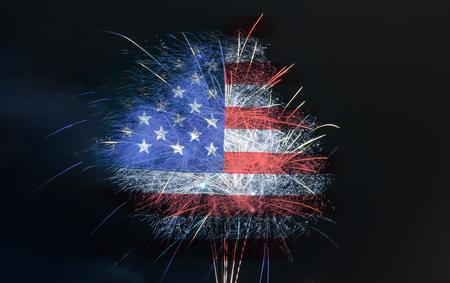 Fireworks burst on holiday or celebration. American flag in background