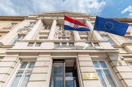 ZAGREB, CROATIA - MAY 07, 2016: Croatian and European flags blowing in the wind on the Croatian parliament building Editorial