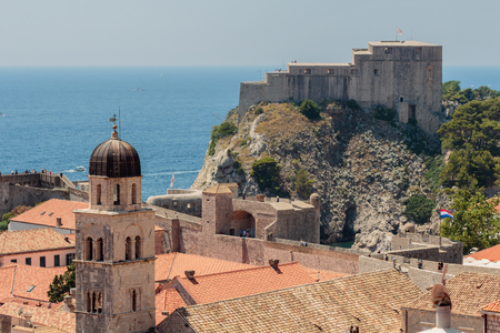 Summer scene of the Dubrovnik Old Town and fort Lovrijenac seen from the wall tour