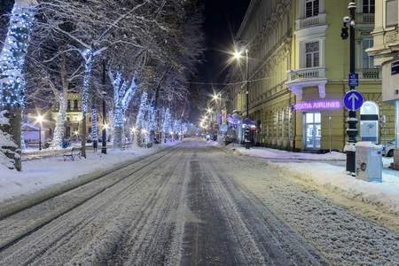 ZAGREB, CROATIA - JANUARY 07, 2016: Road covered with snow in cold winter night in center of Zagreb, Croatia Editorial