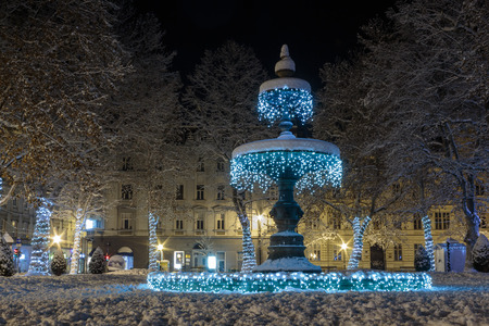 Zrinjevac Fountain decorated by Christmas lights as part of Advent in Zagreb. Fountain is  known as The Mushroom.