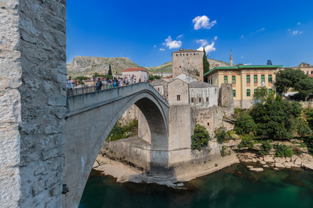 MOSTAR, BOSNIA AND HERZEGOVINA - JULY 13, 2016: The Old Bridge with river Neretva. Stari Most was built in 1557 by Ottomans. Old Bridge is inscribed on World Heritage List by UNESCO in 2005.