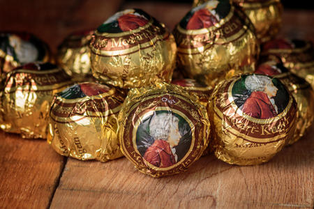 ZAGREB, CROATIA - OCTOBER 16, 2016: The Mozartkugeln, is a small, round sugar confection made of pistachio marzipan, and nougat, covered with dark chocolate. It was originally known as Mozart-Bonbon