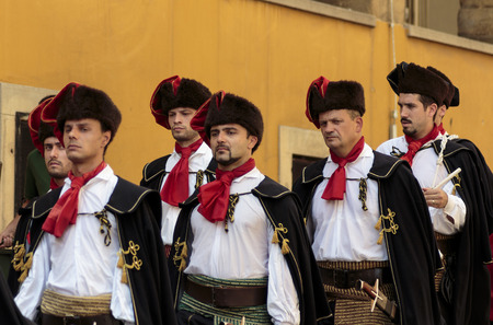 st  marks square: ZAGREB, CROATIA - AUGUST 05, 2015: Lineup Cravat Regiment at a ceremony celebrating the Victory day and the Day of Croatian Defenders at st. Marks square in Zagreb, Croatia.