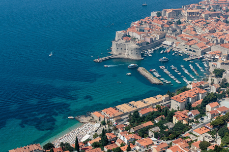 Old port, St. John fort in the Town of Dubrovnik and famous beach Stock Photo