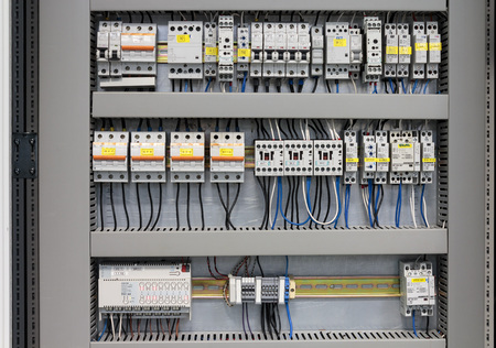 SAMOBOR, CROATIA - JANUARY 09, 2015: Cabinet with Siemens and Schrack electrical installations. Siemens and Schrack are one of the best known manufacturers of electrical installation and electrical switches. Editoriali