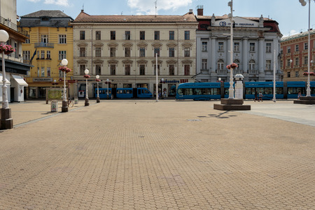ZAGREB, CROATIA - JUNE 6, 2015: Ban Jelacic Square, central square of the city, and new tram in the distance. The oldest standing building here was built in 1827.
