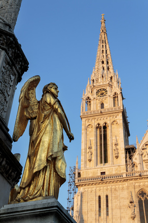angels fountain: Gold Angel sculpture, fountain in front of cathedral in Zagreb, Croatia