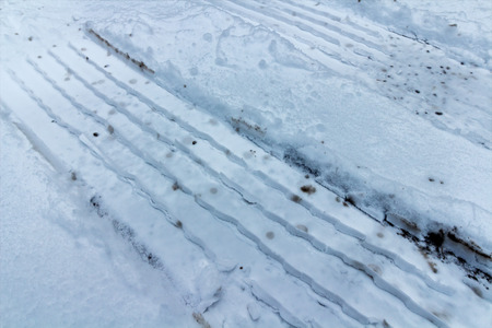 Tire trails in fresh snow Stock Photo
