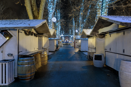 Zrinjevac park in the cold winter night and closed stands on pathway Stock Photo