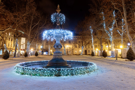 Zrinjevac park Fountain decorated by Christmas lights as part of Advent in Zagreb. Fountain is known as The Mushroom. Editorial