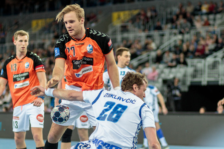 ZAGREB, CROATIA - FEBRUARY 25, 2016: EHF Champions League PPD Zagreb VS IFK Kristianstad. David MIKLAVCIC (28) and Gunnar Steinn JONSSON (27) Editorial