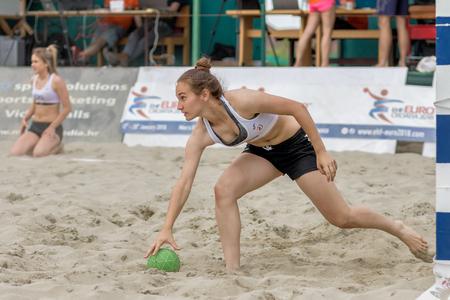 ZAGREB, CROATIA - JUNE 10, 2017: Croatian beach handball championship. Goalie picking up the ball