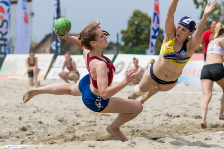 ZAGREB, CROATIA - JUNE 10, 2017: Croatian beach handball championship. Handball player spin shoot at the goal